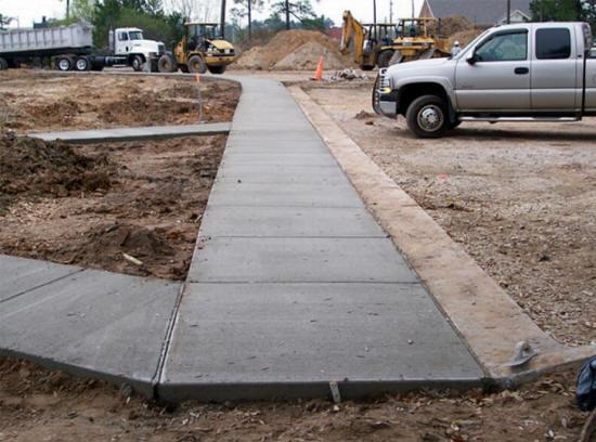 Concrete contractors repair pour concrete driveway for How to pour a concrete driveway
