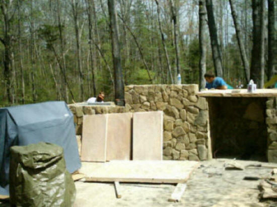 Outdoor kitchens fireplace construction builders cost for Cost of outdoor living space