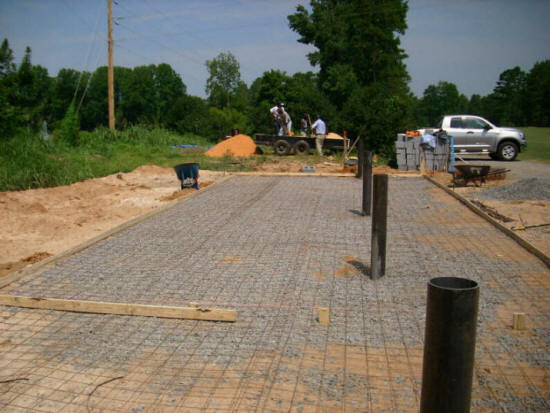 Cost to pour concrete patio slab pouring a concrete patio for Poured concrete basement cost